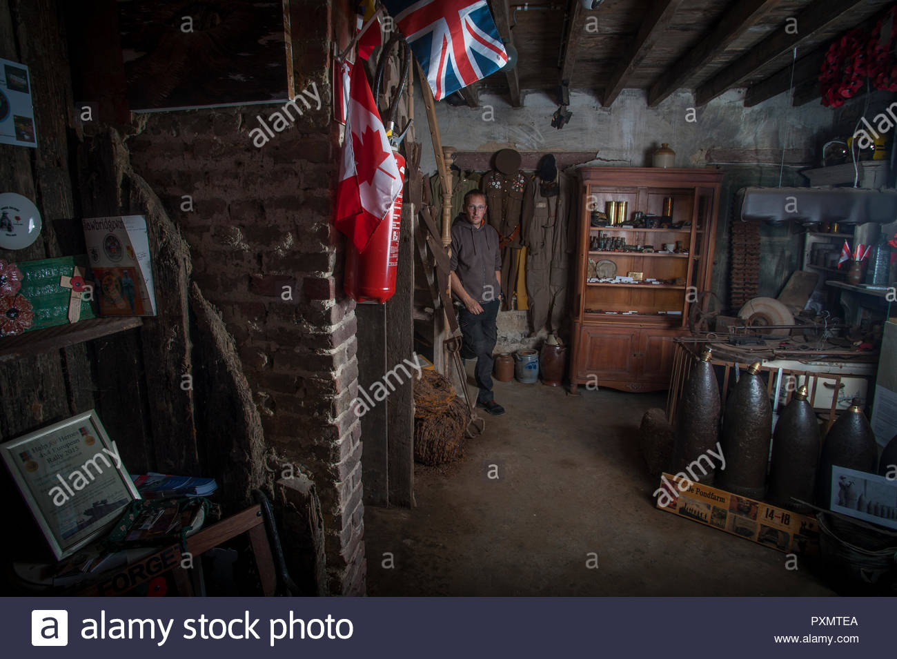 30 year old Stijn Butaye in his self made WW1 museum at the family farm Pond Farm, Langemark, Belgium - Stock Image