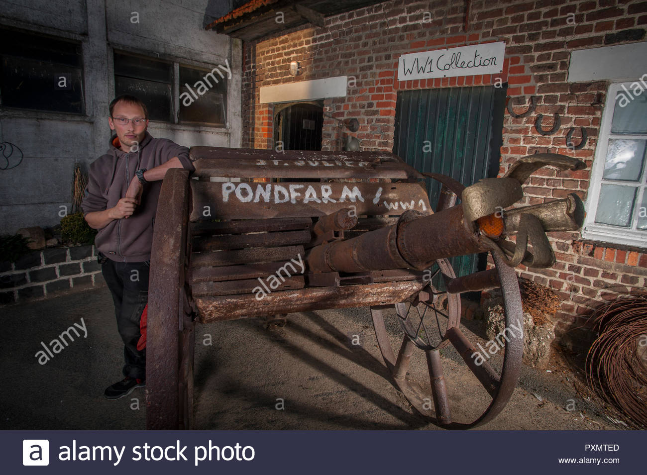 30 year old Stijn Butaye outside his self made WW1 museum at the family farm Pond Farm, Langemark, Belgium. - Stock Image