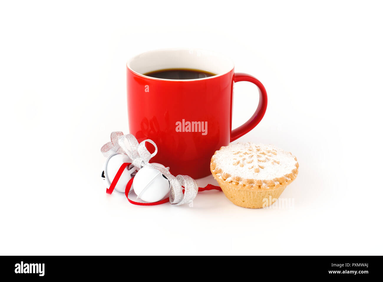 Red mug filled with black coffee ,decorated with white jingle bells, silver metallic ribbon, and a mince pie on white background. - Stock Image