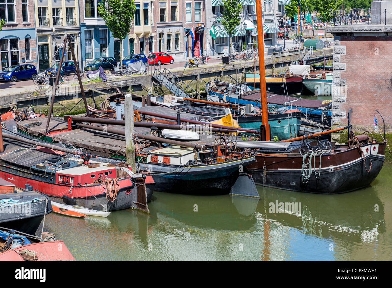 boats anchored in a canal in the city of Rotterdam in the Netherlands Holland - Stock Image