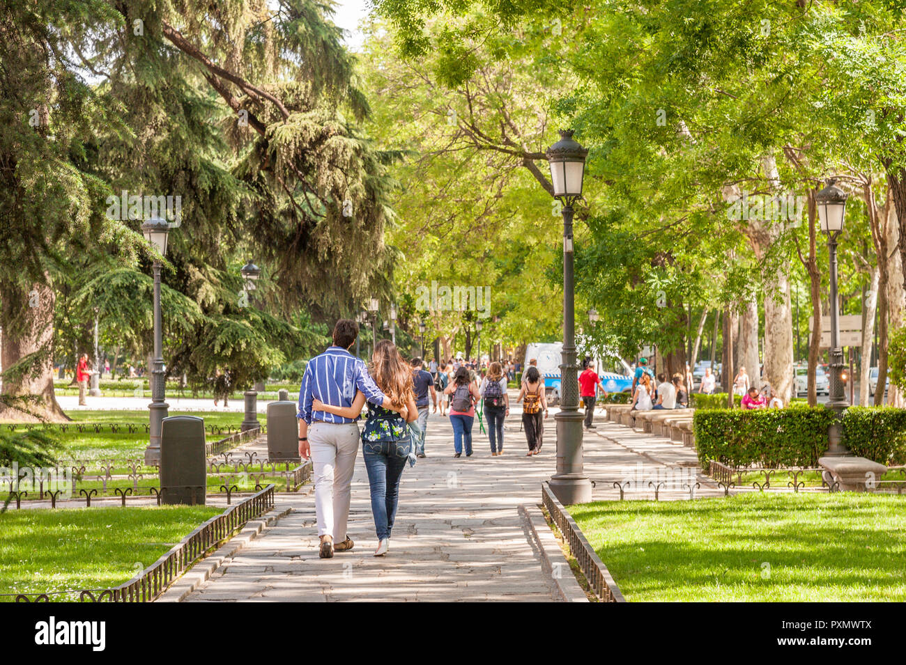 Young couple walking down the Paseo del Prado, Madrid, Spain - Stock Image