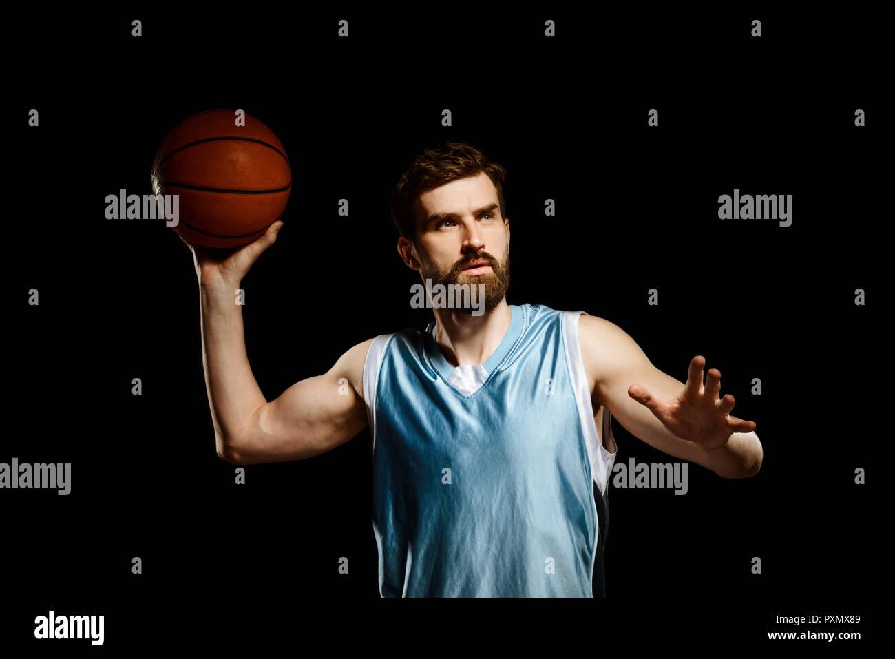 Handsome basketball player shooting ball Stock Photo