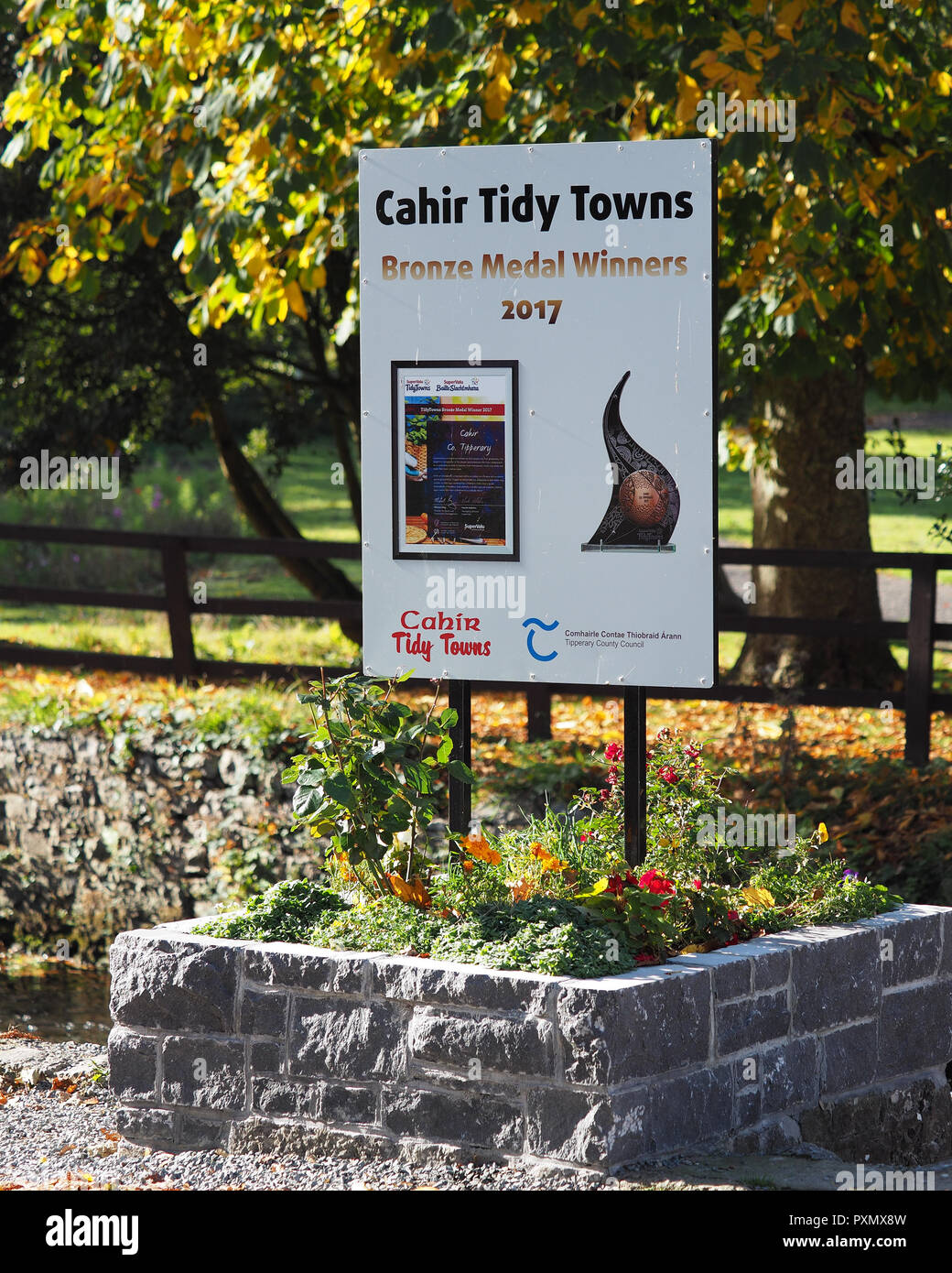 Sign beside Cahir Castle in Tipperary, Ireland showing that Cahir town was a bronze medal winner in the tidy towns competition 2017. Cahir, Tipperary, - Stock Image