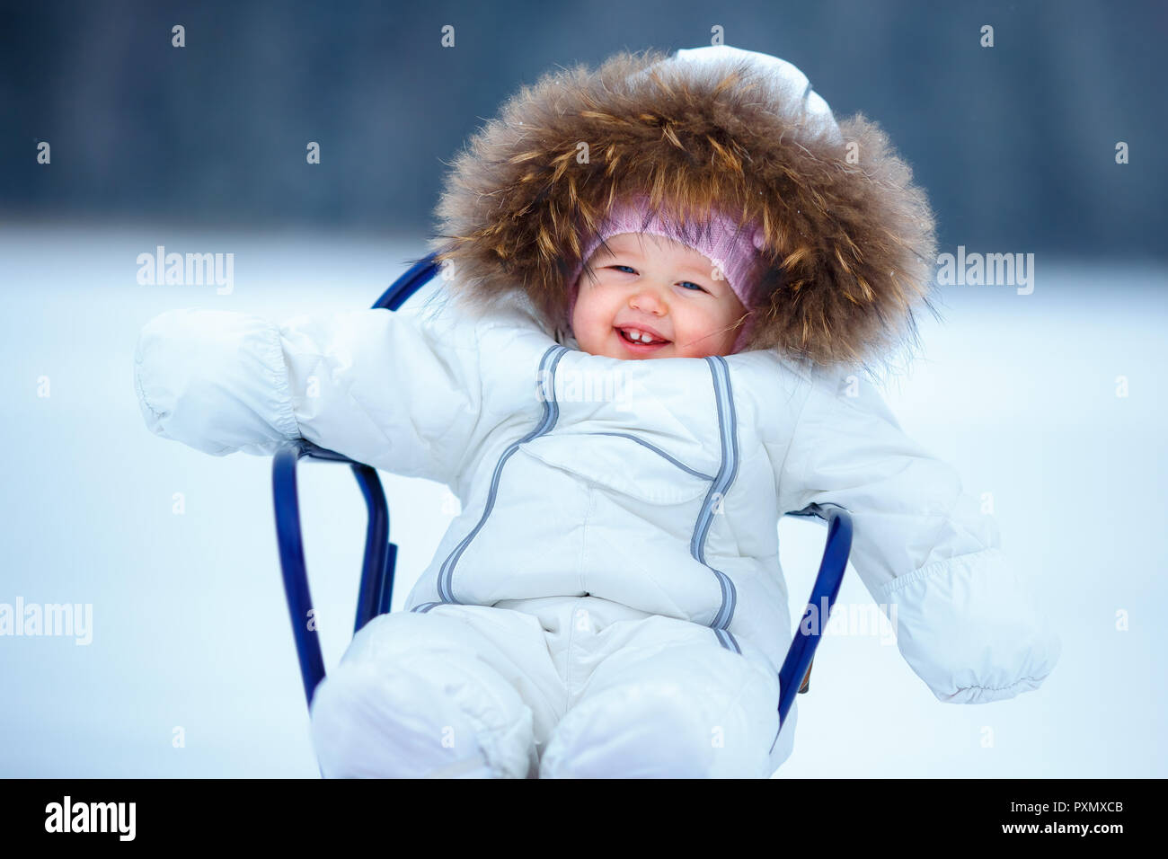 18dfe1c6fe5a Sled and snow fun for kids. Baby sledding in snowy winter park ...