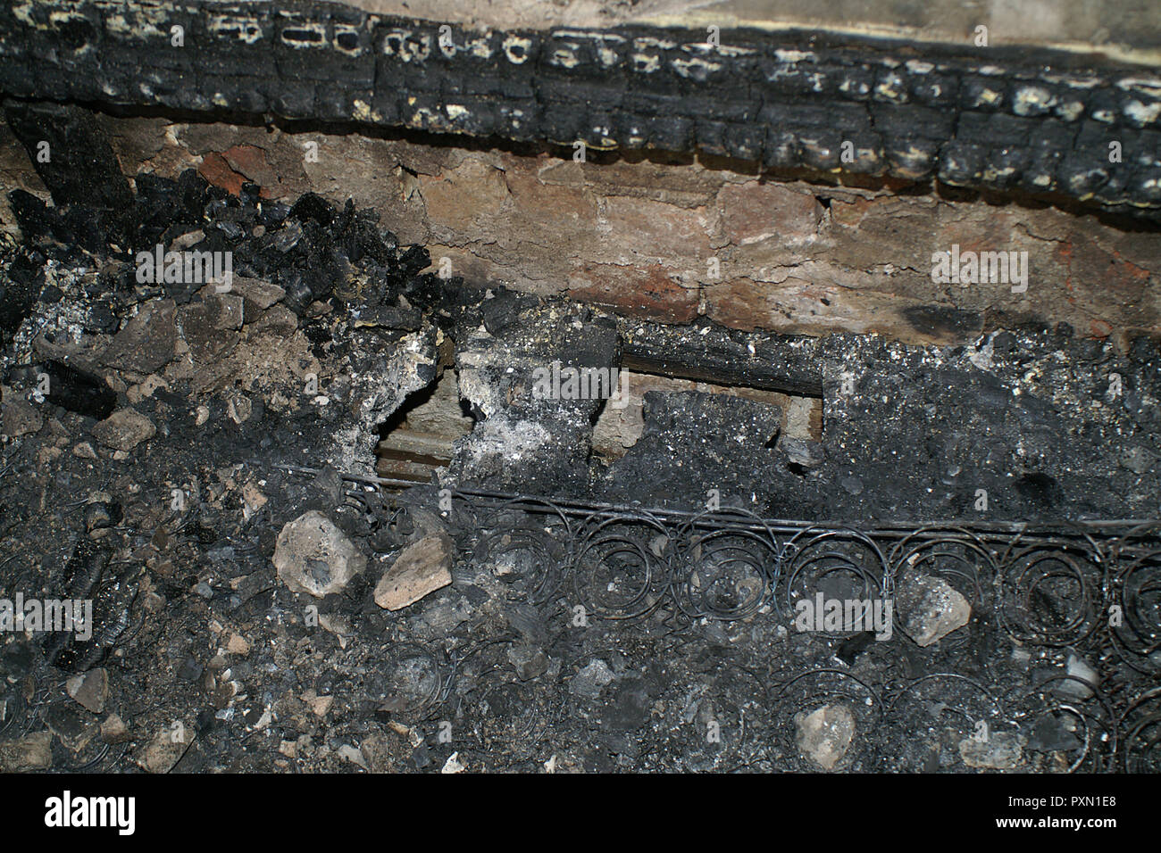 electrical fire, burned electrical socket Stock Photo