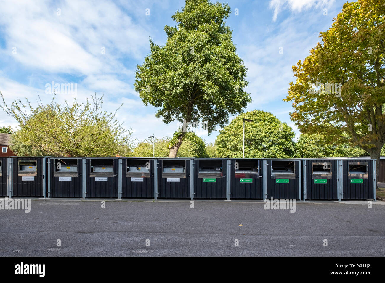 Row of recycle containers or bottle and paper bins in Crewe Cheshire UK - Stock Image