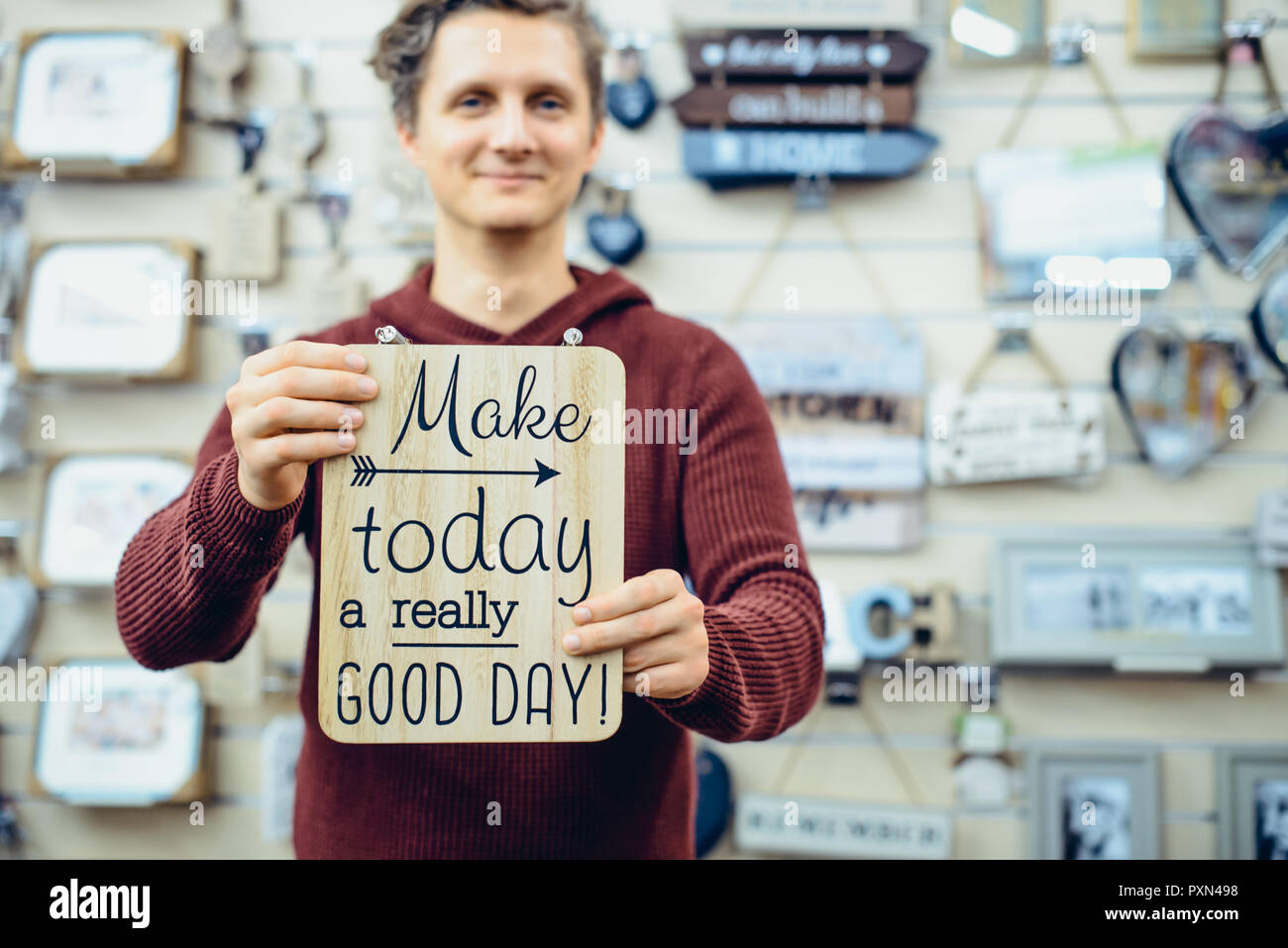 Portrait Of Young Smiling Caucasian Man Holding Motivational Message