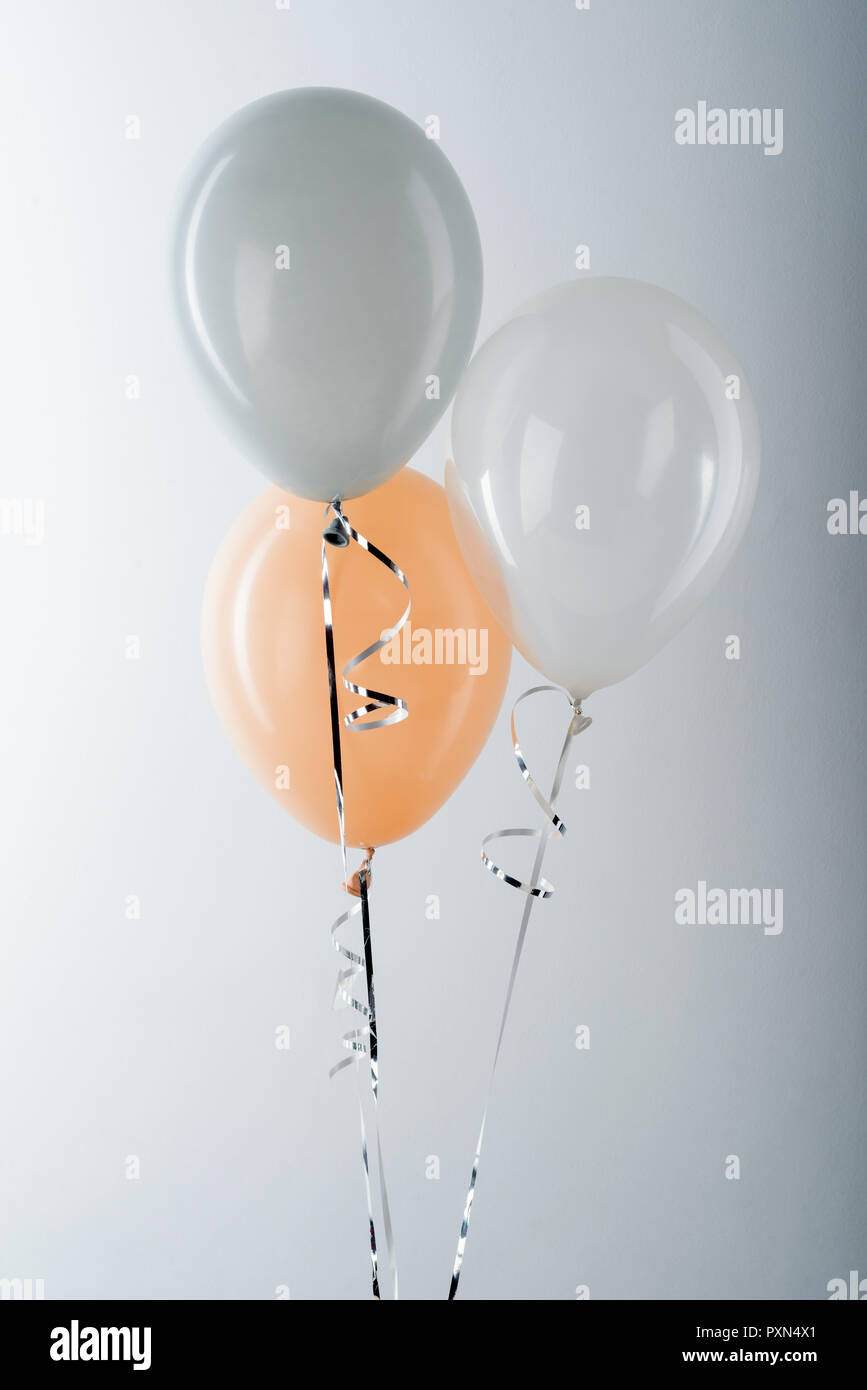 Balloons on neutral background - Stock Image