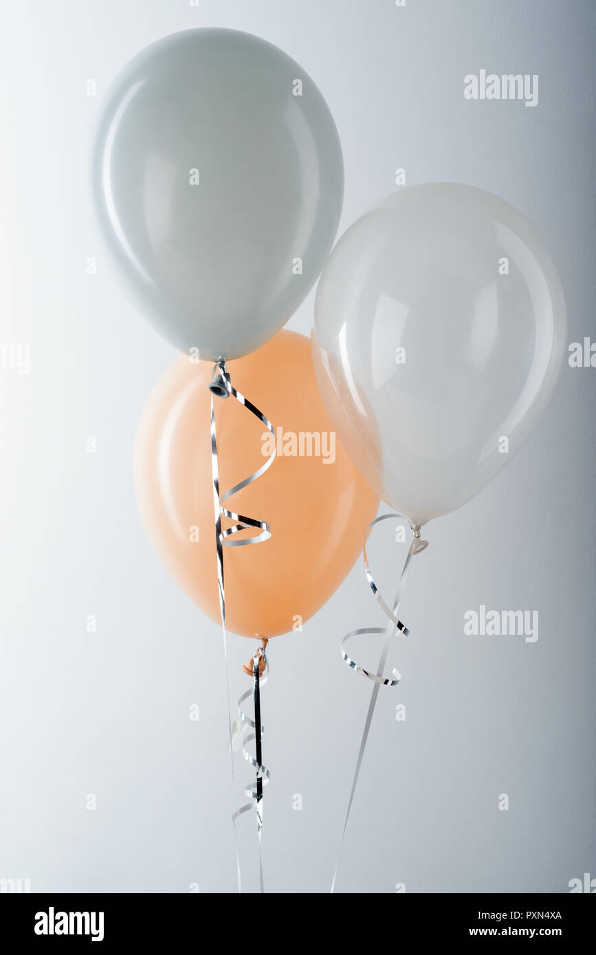 Balloons and metallic silver ribbon - Stock Image