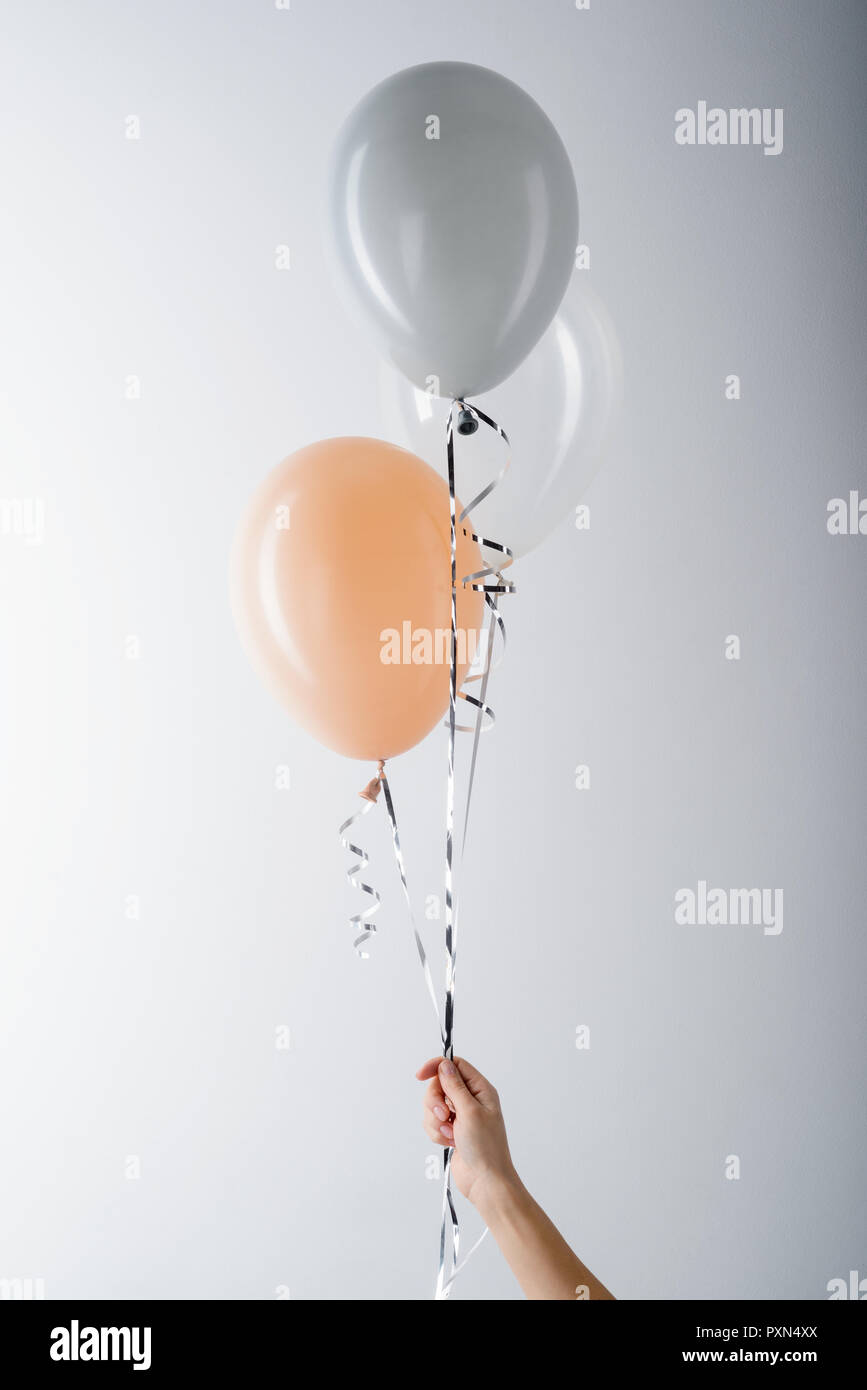 Peachy and grey balloons - Stock Image