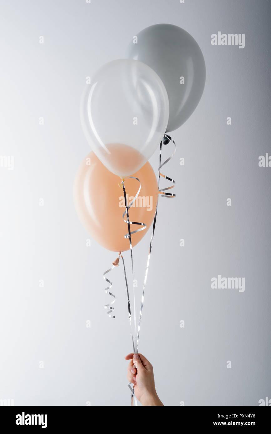 Balloons on light grey background - Stock Image