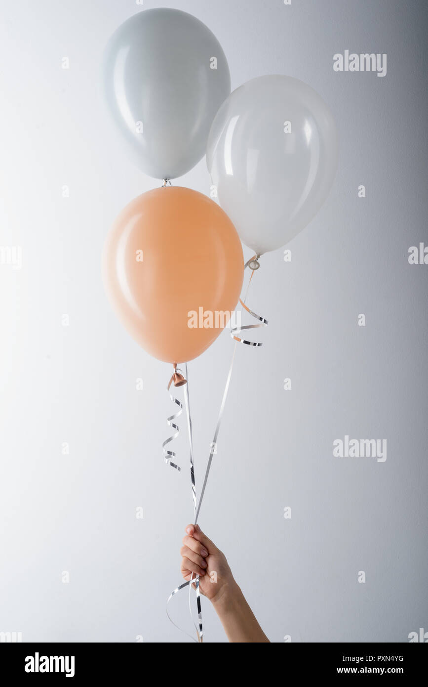 Grey, peachy and white balloons - Stock Image