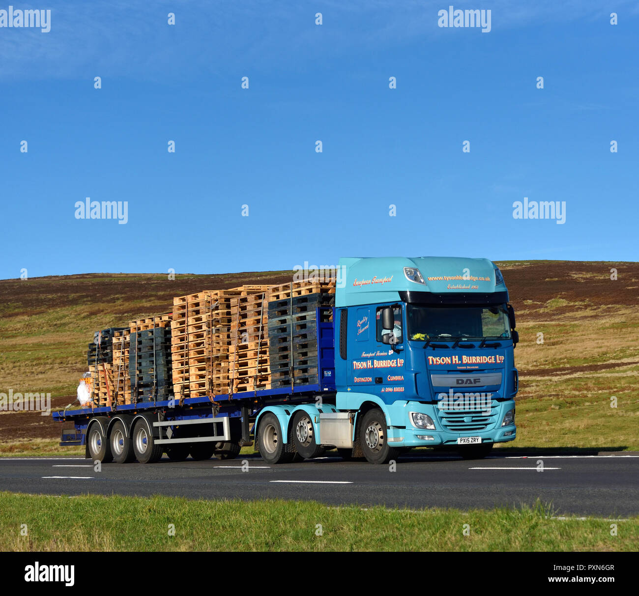 Tyson H. Burridge  Limited HGV, with load of wooden pallets. M6 motorway Southbound carriageway, Shap, Cumbria, England, United Kingdom, Europe. - Stock Image