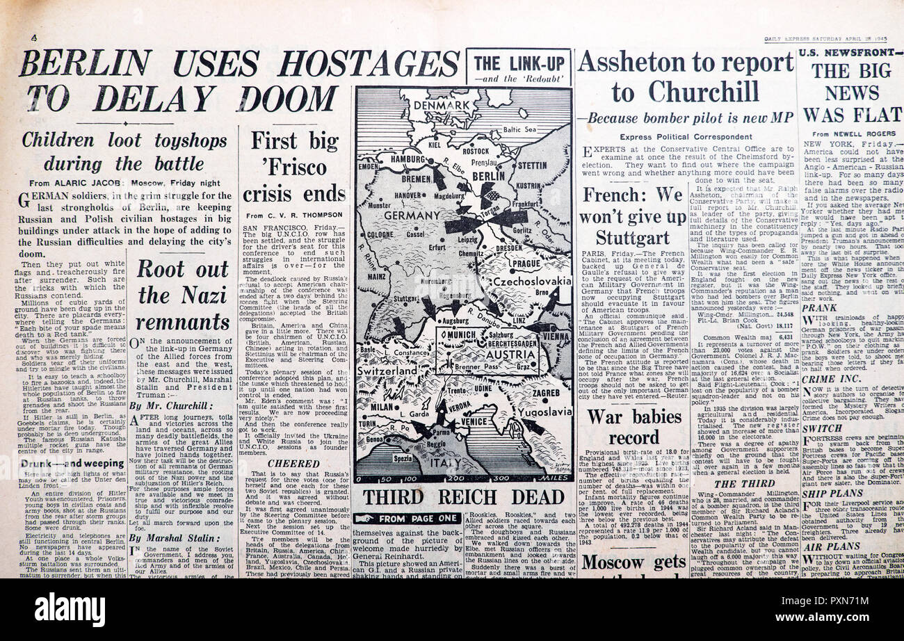 'Third Reich Dead' and 'Berlin Uses Hostages to Delay Doom'  in Daily Express Second World War newspaper April 28 1945 historical archive England UK - Stock Image