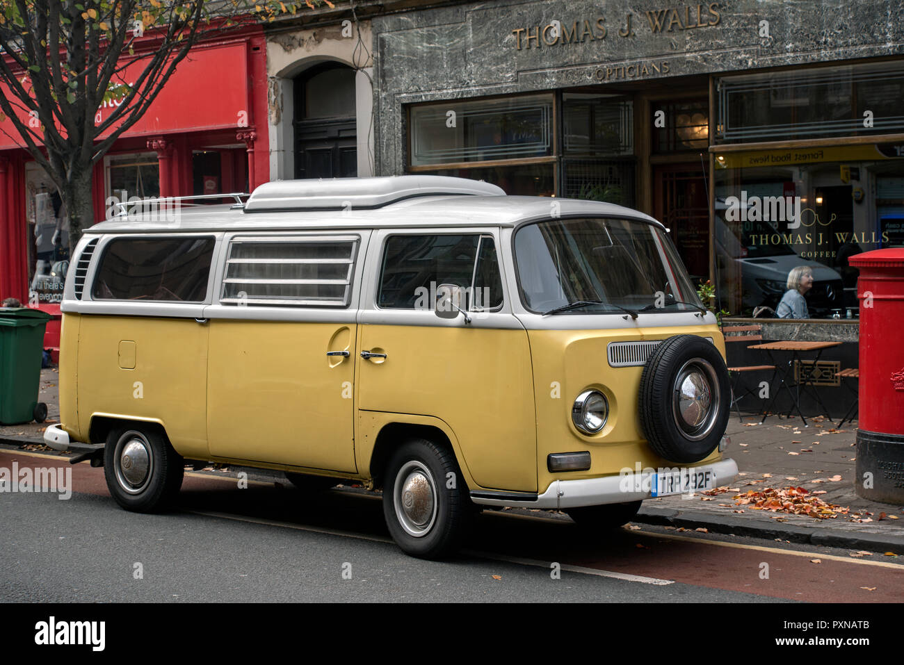 Yellow and white Volkswagen Campervan parked in Edinburgh's Old Town. - Stock Image