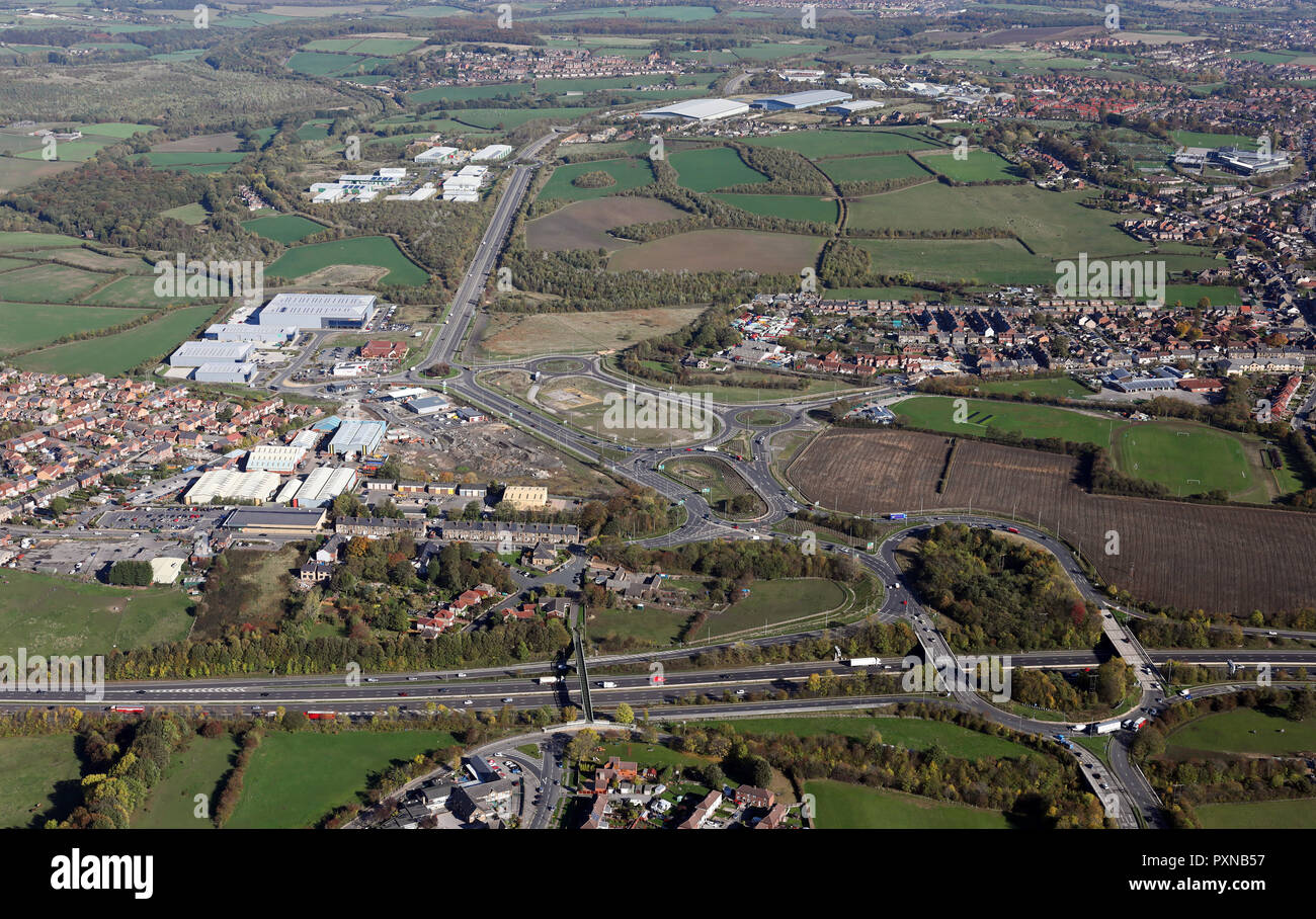 aerial view from overhead junction 36 of M1 motorway looking east along A6195 to various Dearne Valley industrial estates, Barnsley, Sth Yorkshire - Stock Image