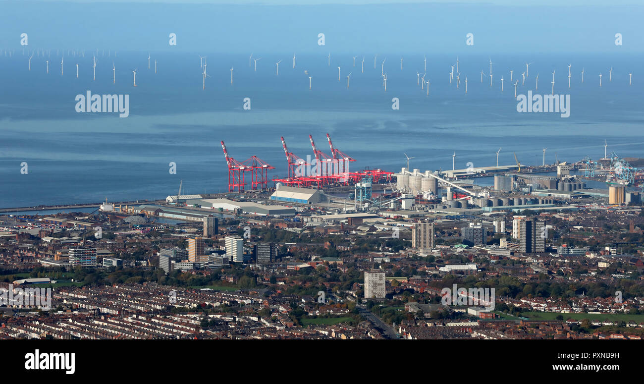an aerial view of the Bootle Seaforth Docks skyline towards wind turbines in the Irish Sea, Liverpool - Stock Image