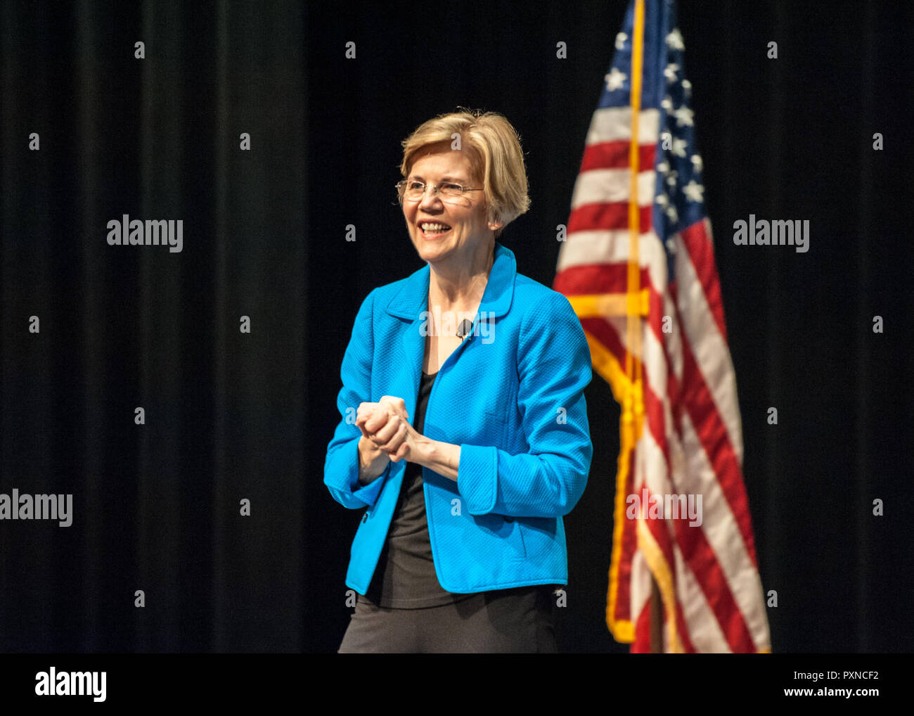 A smiling Senator Elizabeth Warren on stage at a town hall Stock Photo