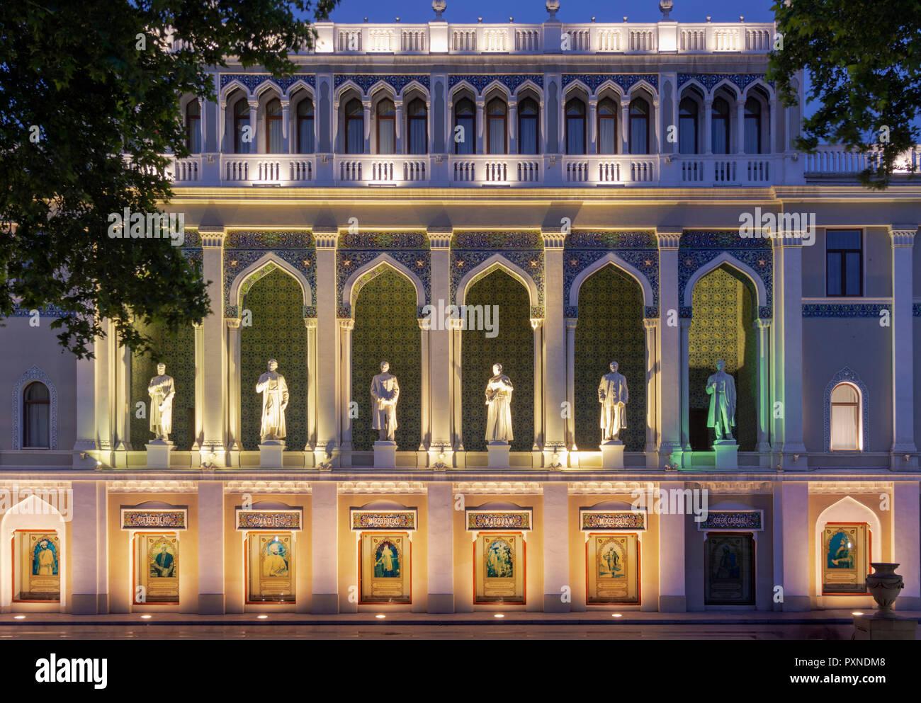 The Nizami Museum of Azerbaijani Literature in Baku, named after the great romantic epic poet Nizami Ganjavi. The statues are of famous Azerbaijani writers. Azerbaijan - Stock Image