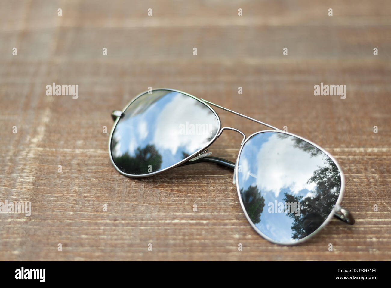 Classic avionics sunglasses on brown wooden surface - Stock Image