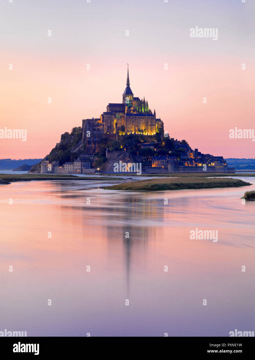 France, Normandy, Le Mont Saint Michel reflected in river at night - Stock Image