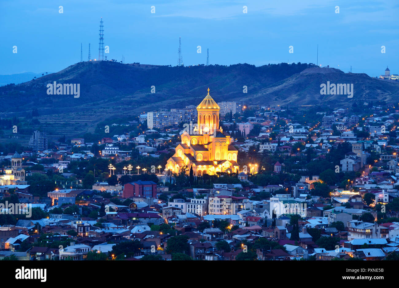 Holy Trinity Cathedral (Tsminda Sameba) the biggest Orthodox Cathedral in the Caucasus, at dusk. Tbilisi, Georgia. Caucasus Stock Photo