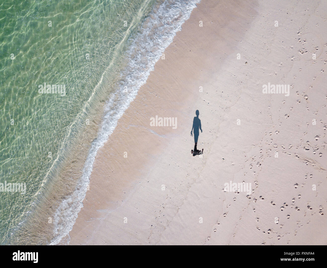 Indonesia, Bali, Aerial view, beach stroll, shadow of person - Stock Image
