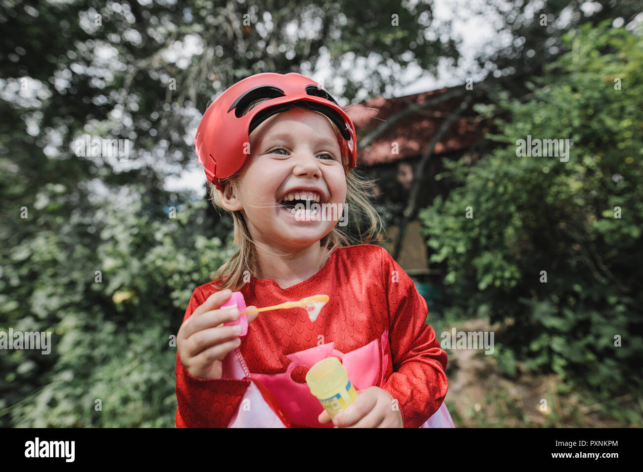 Portrait of laughing masqueraded little girl having fun Stock Photo