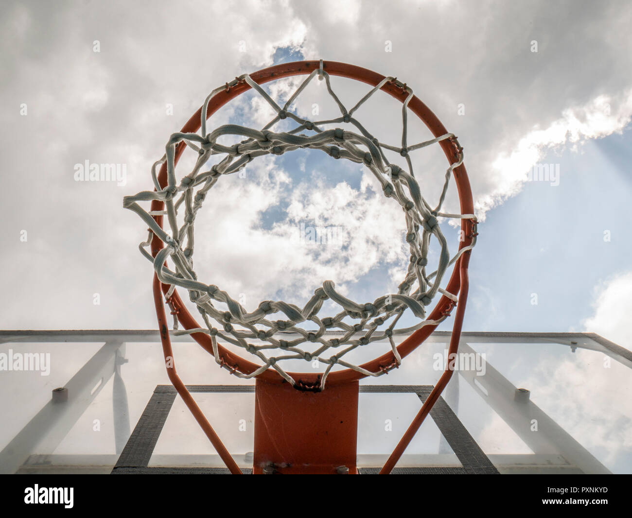 Basketball hoop against clouded sky - Stock Image