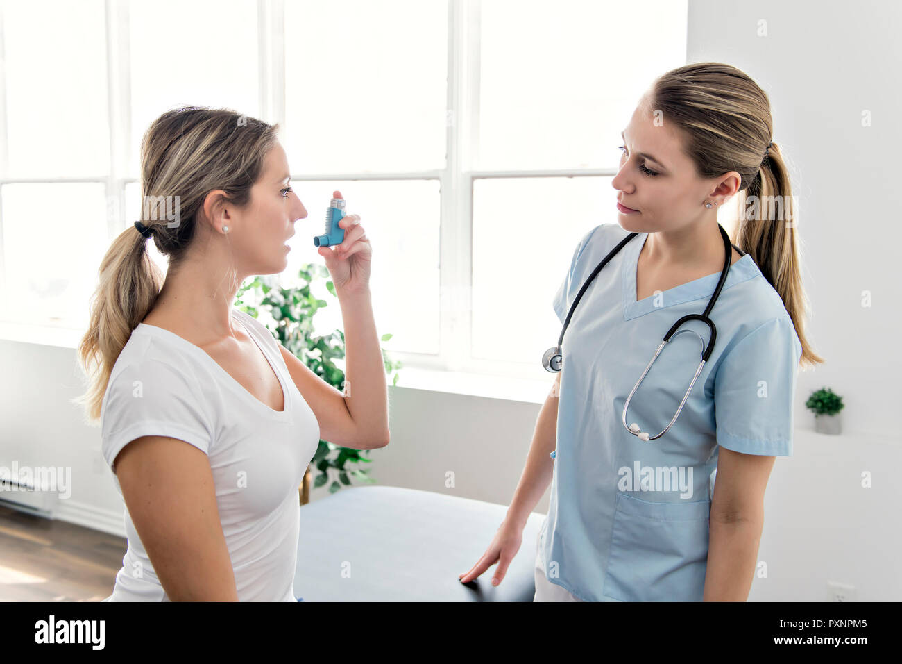 Asthma Woman with doctor at the hospital Stock Photo
