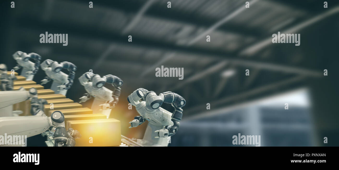 iot industry 4.0 technology concept.Smart factory using trending automation robotic arms with part on conveyor belt in operation line. Automotive manu - Stock Image