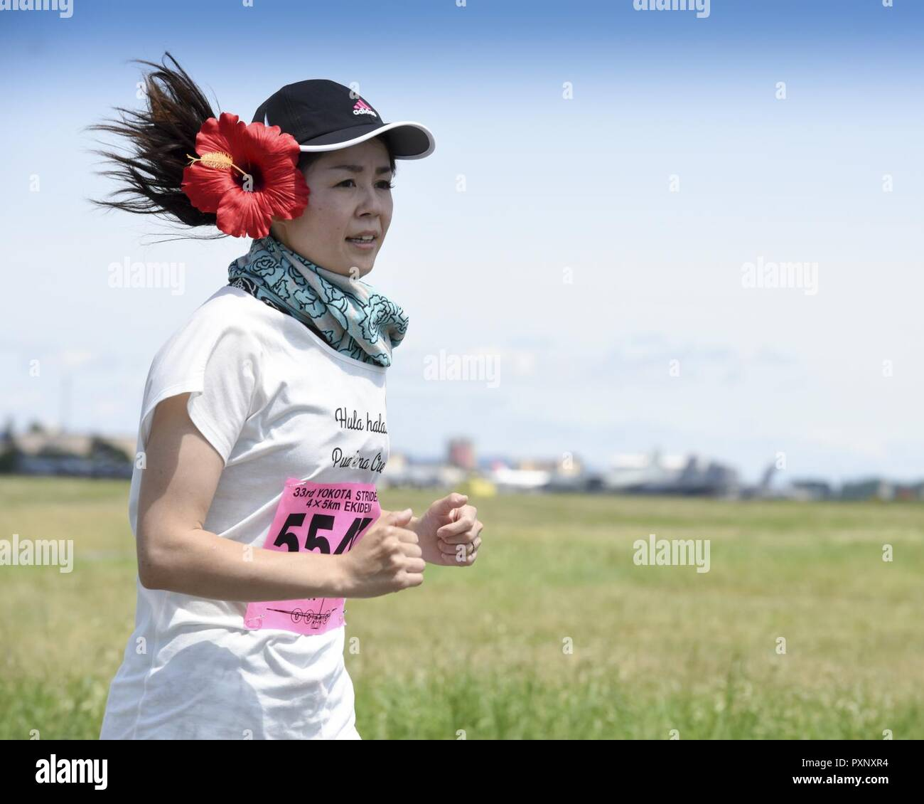 A runner participates in the 5K Race during the 33rd Annual Yokota Striders Ekiden at Yokota Air Base, Japan, June 4, 2017. The races, which consisted of a 2K Kids Run, 2K Family Run, 5K Race and the main Ekiden Race event, promoted friendship and  physical fitness. - Stock Image