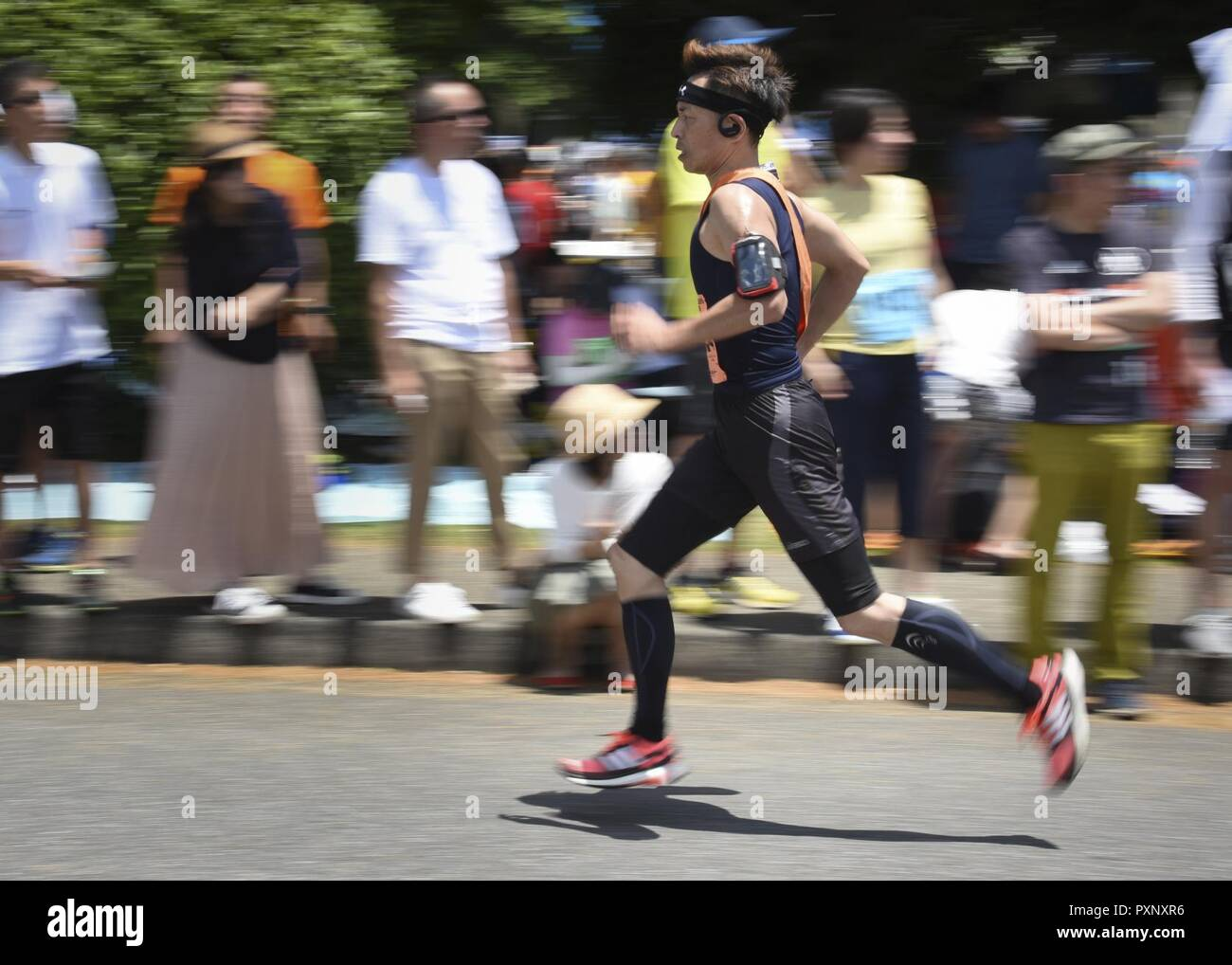 A participant runs the Ekiden Race at Yokota Air Base, Japan, June 4, 2017. More than 5,000 runners participated in the event hosted by the Yokota Striders Running Club. - Stock Image