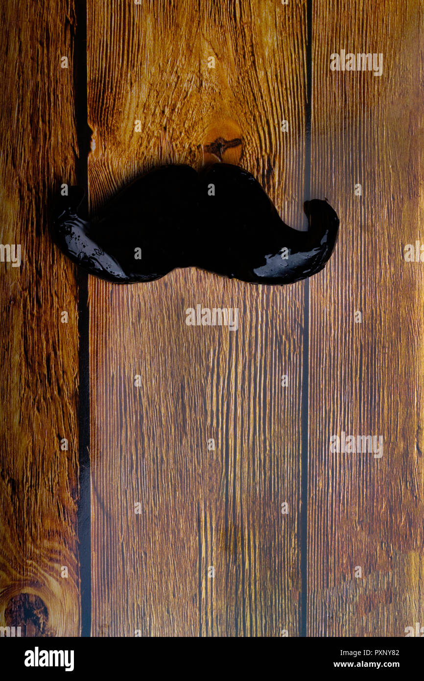 moustache symbol on wooden texture, Fake moustache on vintage background.. Photo props mustaches. Birthday and Party Set and wedding. Flat lay, top vi - Stock Image
