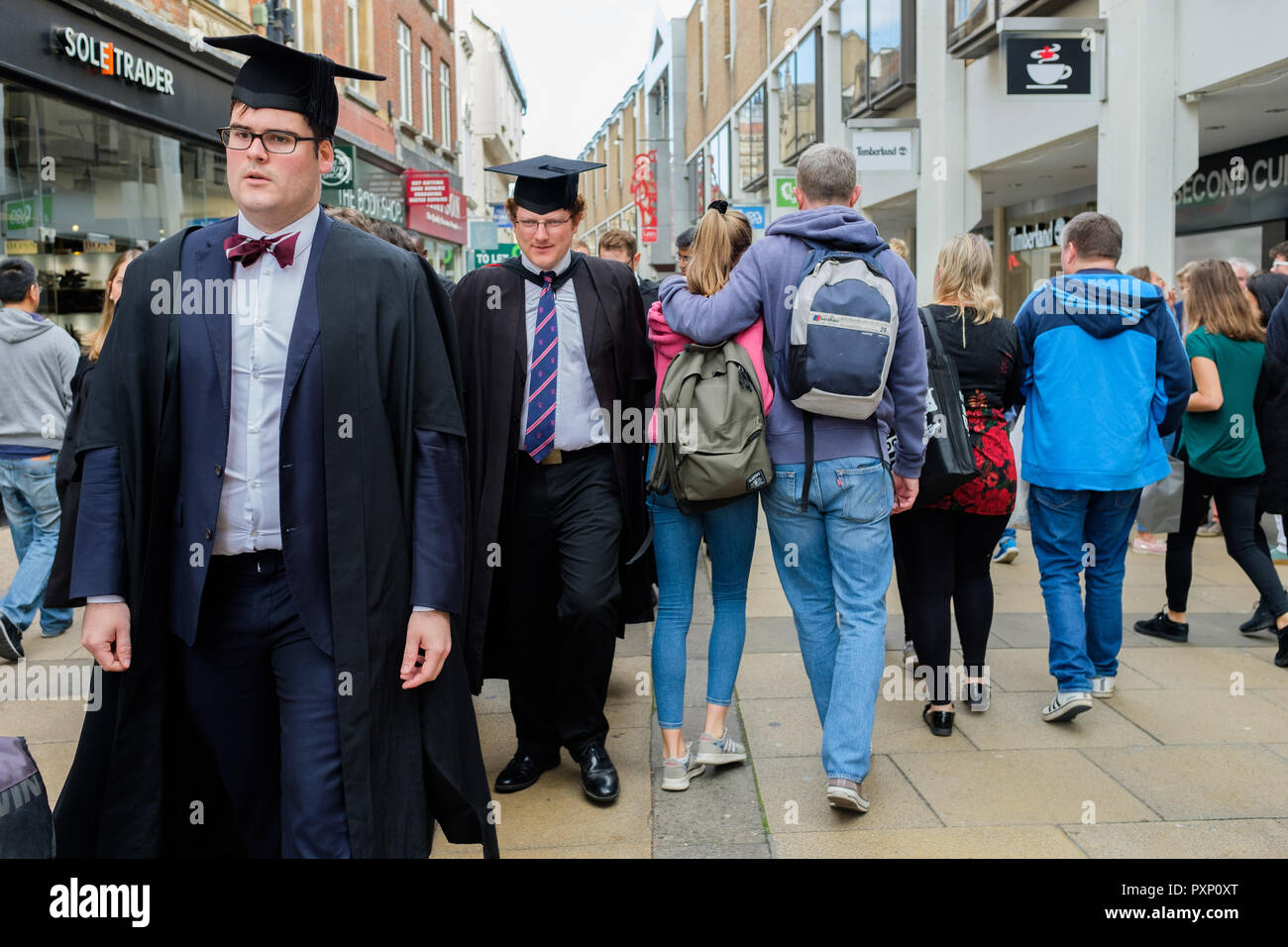 Town and Gown. Michaelmas Term degree procession through Cambridge City centre. - Stock Image