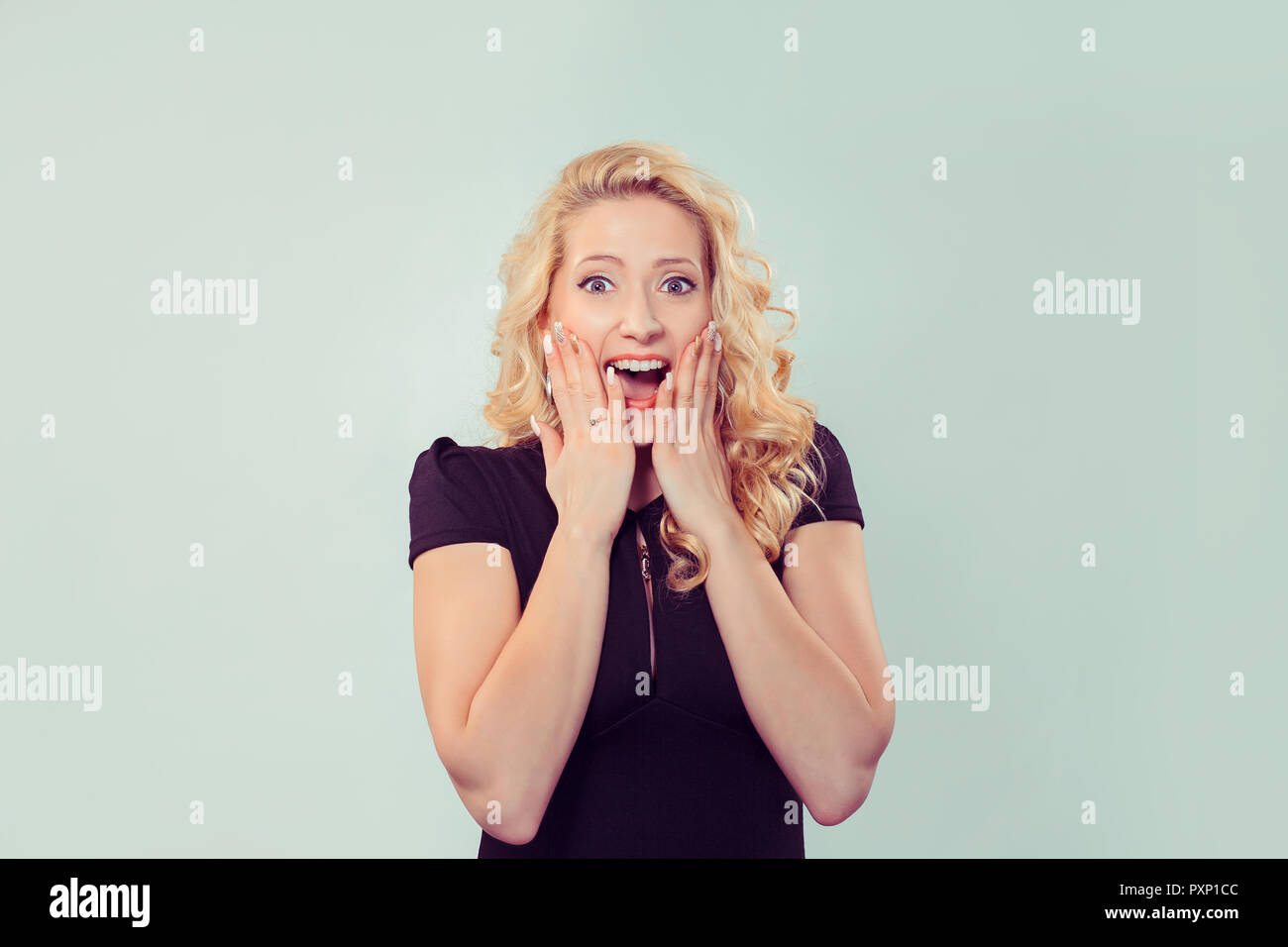 Super amazed screaming woman - Stock Image