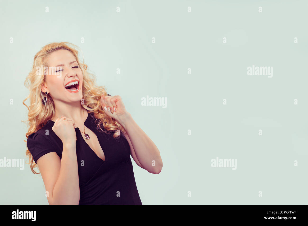 Laughing woman happy with win - Stock Image
