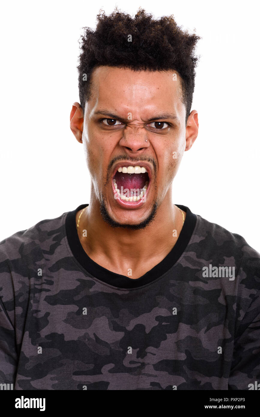 Face of young angry African man shouting - Stock Image