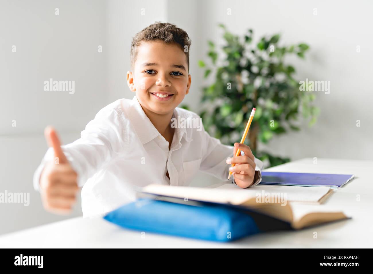a cute black boy doing homework at home stock photo 222991849 alamy rh alamy com Not Doing Homework Family Doing Homework