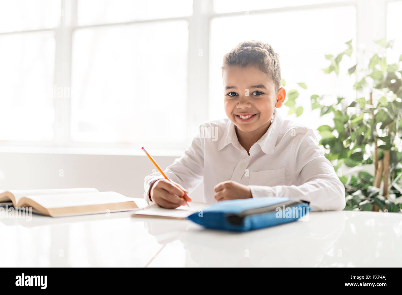 a cute black boy doing homework at home stock photo 222991850 alamy rh alamy com Doing Math Homework Doing Math Homework
