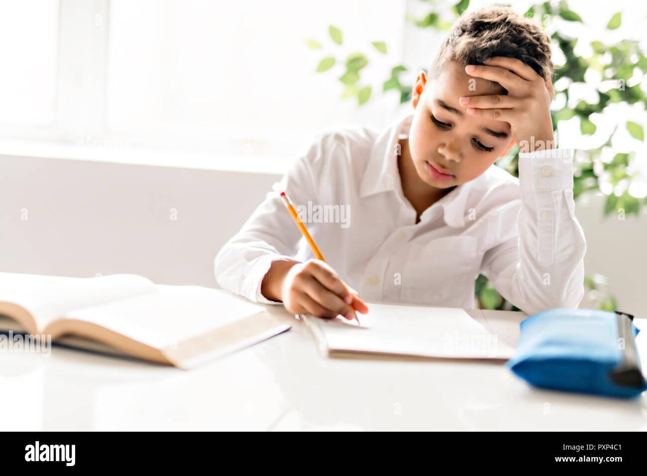 a cute black boy doing homework at home stock photo 222991889 alamy rh alamy com Doing Home Work Boy Doing His Homework