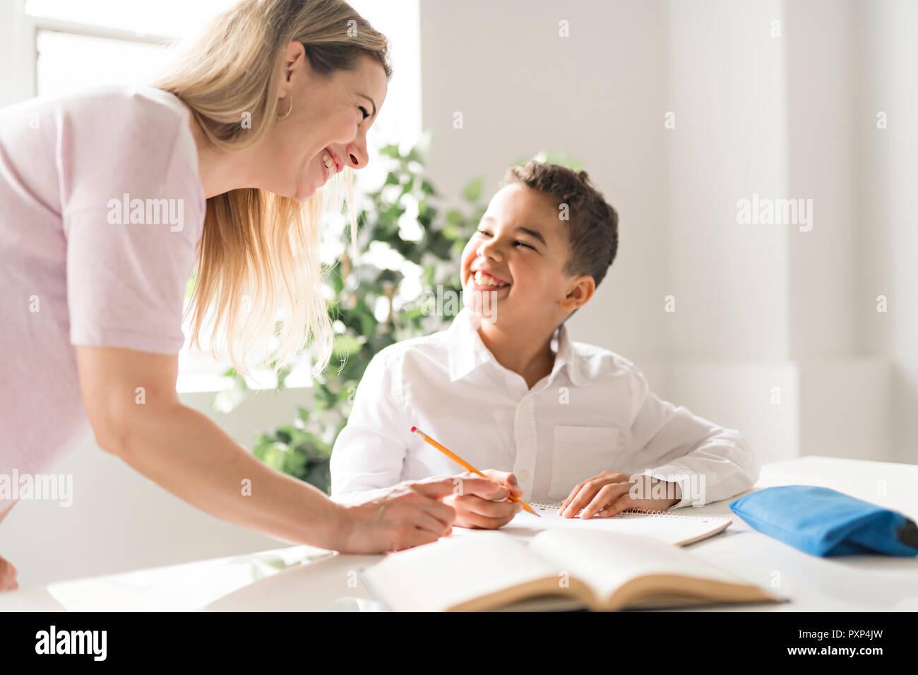 mother help black boy doing homework at home stock photo 222992081 rh alamy com Doing Home Work Doing Math Homework