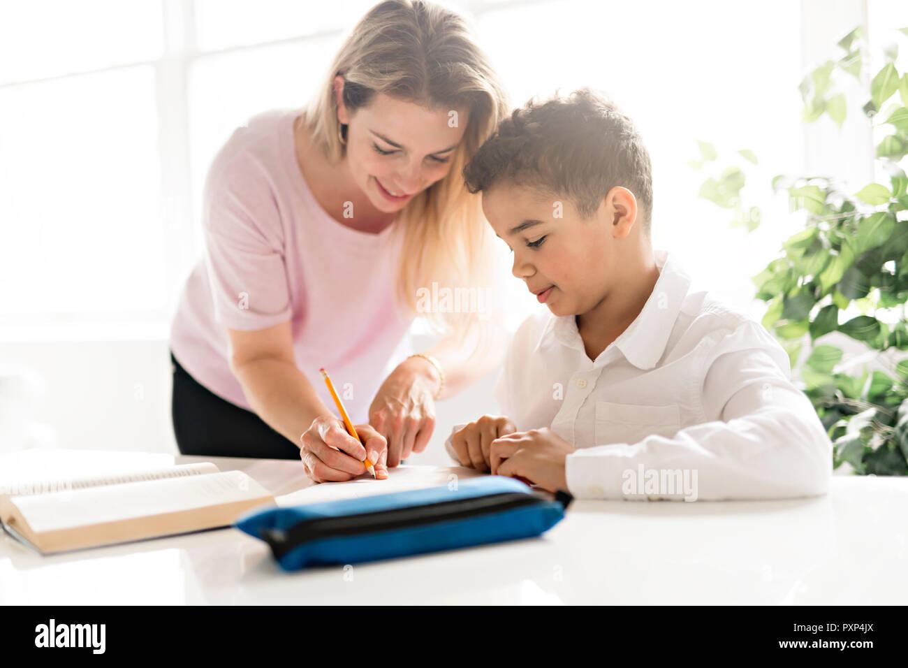 mother help black boy doing homework at home stock photo 222992082 rh alamy com Family Doing Homework Doing Homework at Lunch