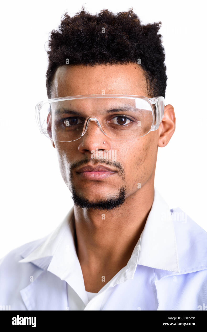 053a7a464df1 Face of young African man doctor wearing protective glasses Stock ...