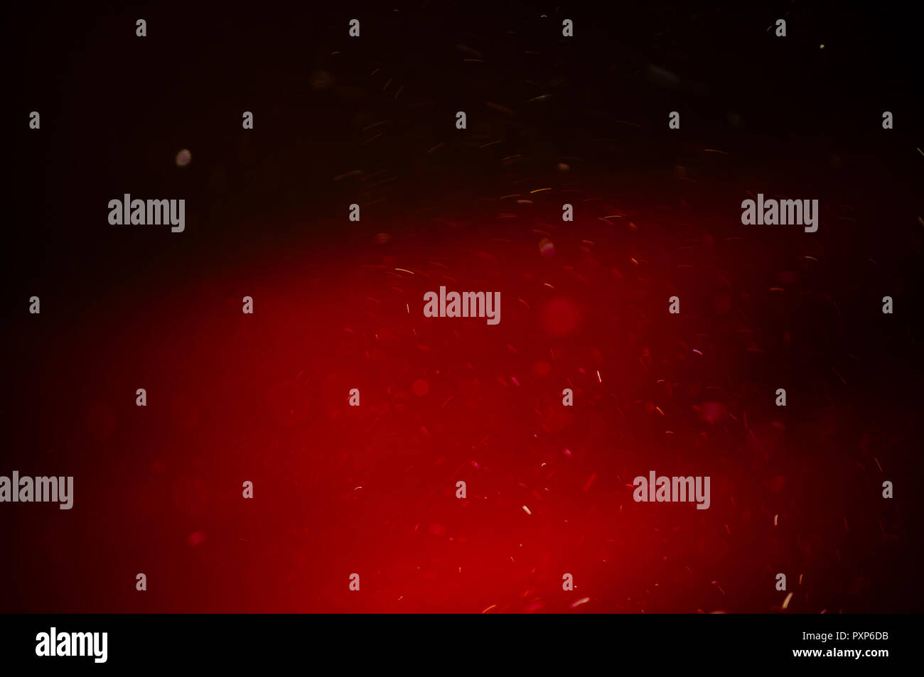 Abstract lighting sparkles on red drape background - Stock Image