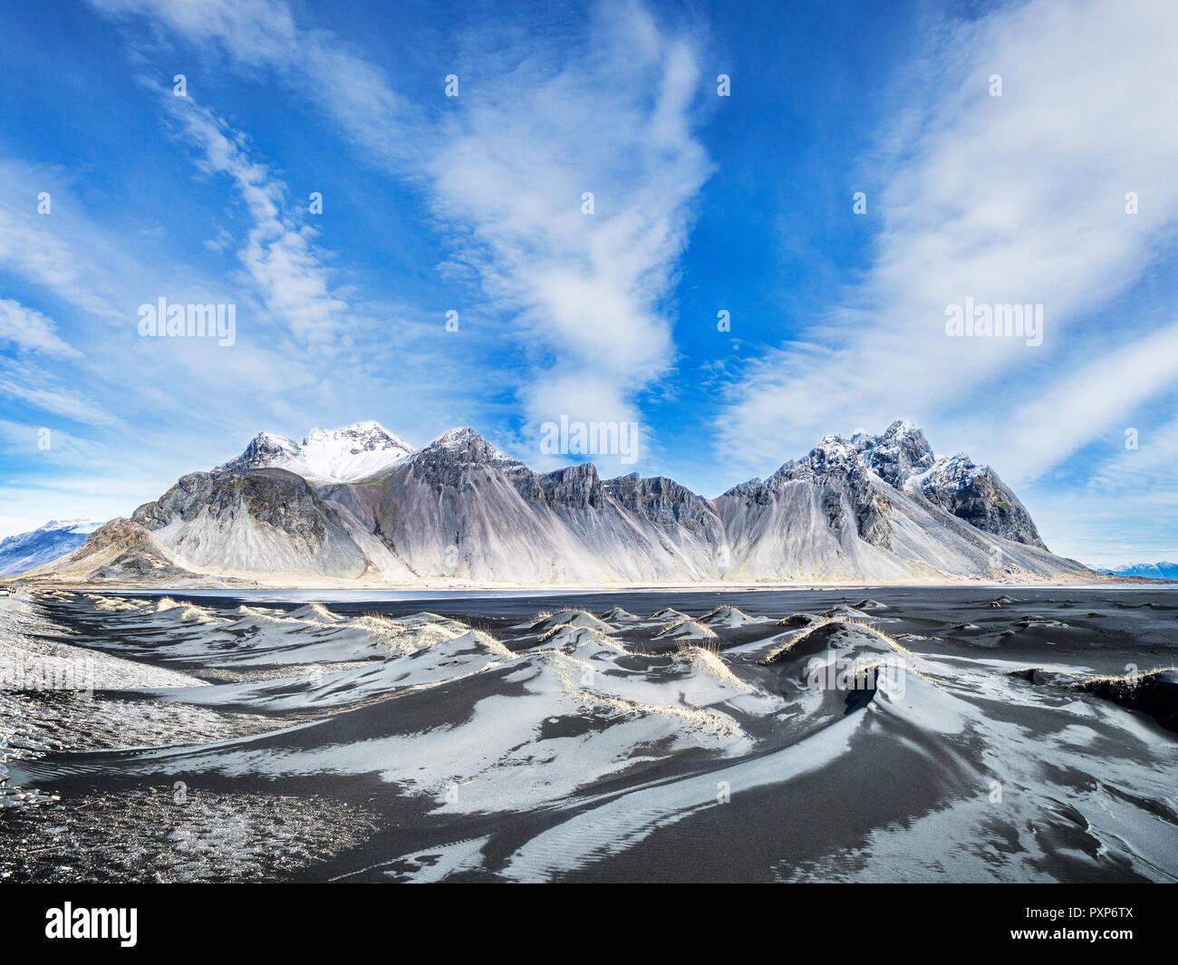 Vestrahorn or Vesturhorn Mountain, South Iceland, seen across the black sand dunes at Stokksnes. - Stock Image