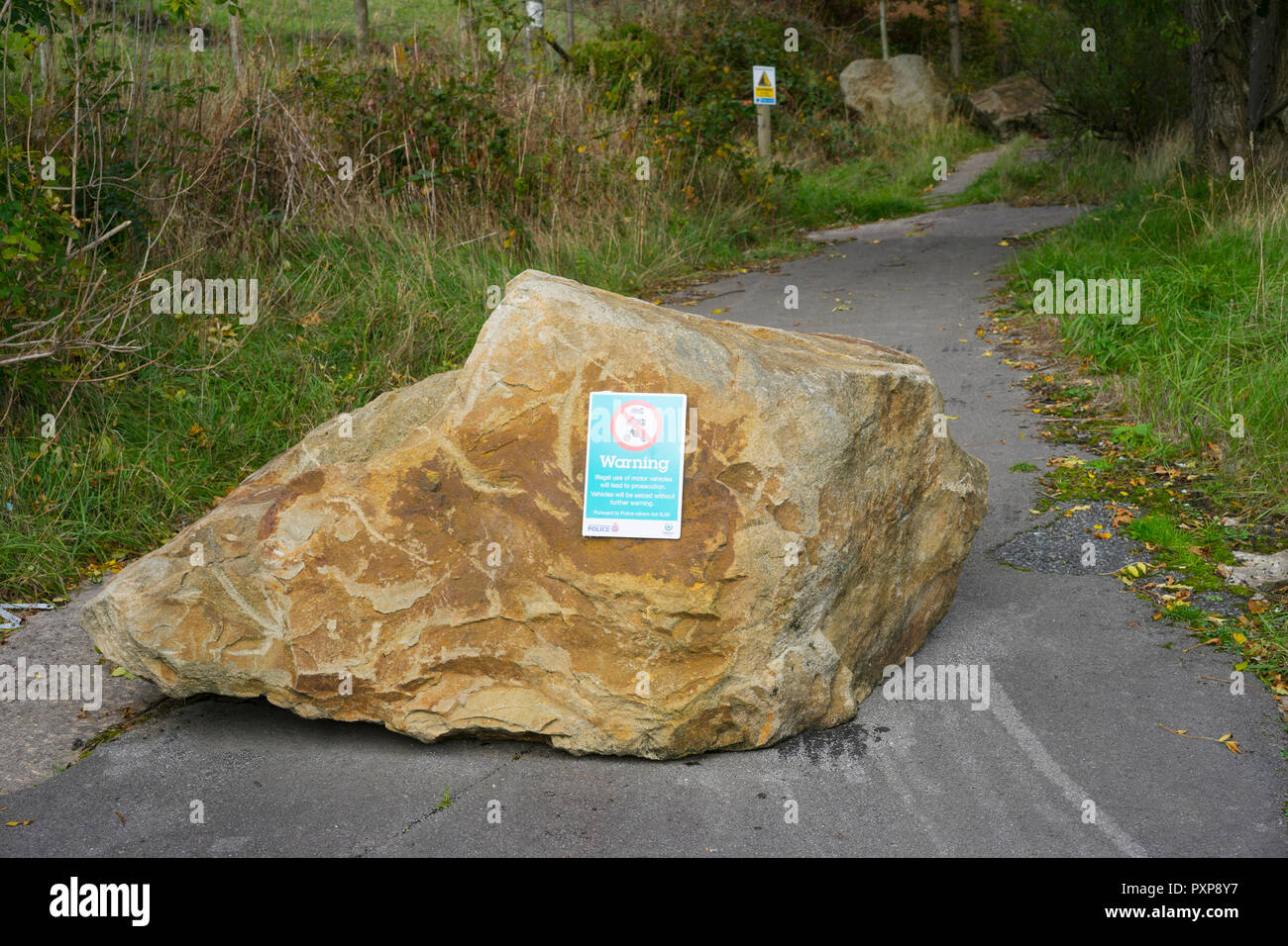 Rocks placed on country path to obstruct riders of motor bikes, Scramblers and Quad bikes from damaging the environment. Greater Manchester, UK. Stock Photo