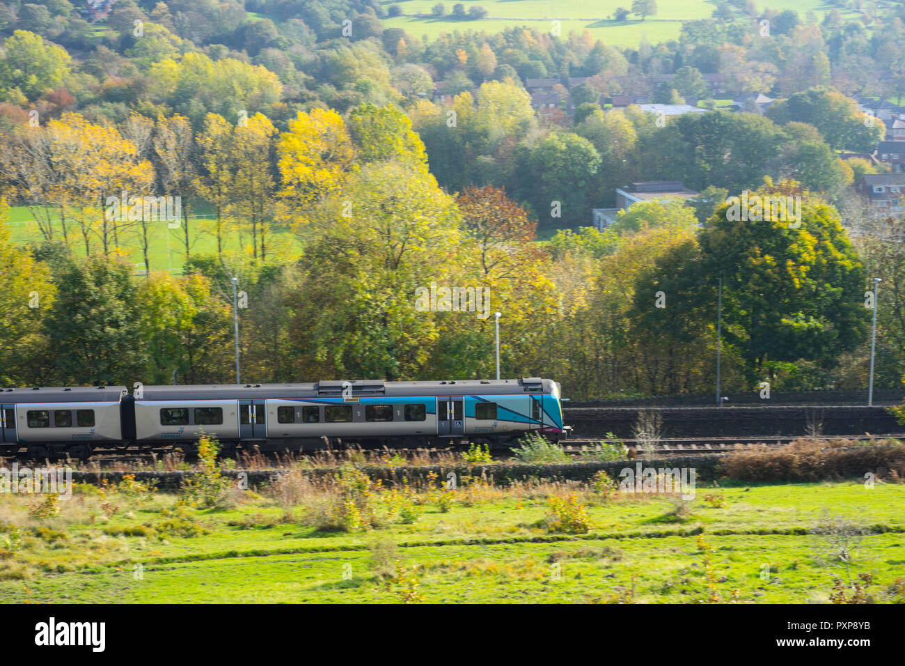 Trans Pennine commuter train passing through Uppermill area heading towards Manchester,Uppermill,Saddleworth, Greater Manchester, UK. - Stock Image