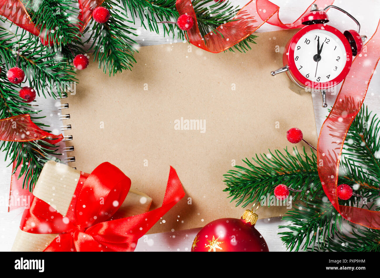 Christmas card with empty notebook and clock, branch fir and xmas ...