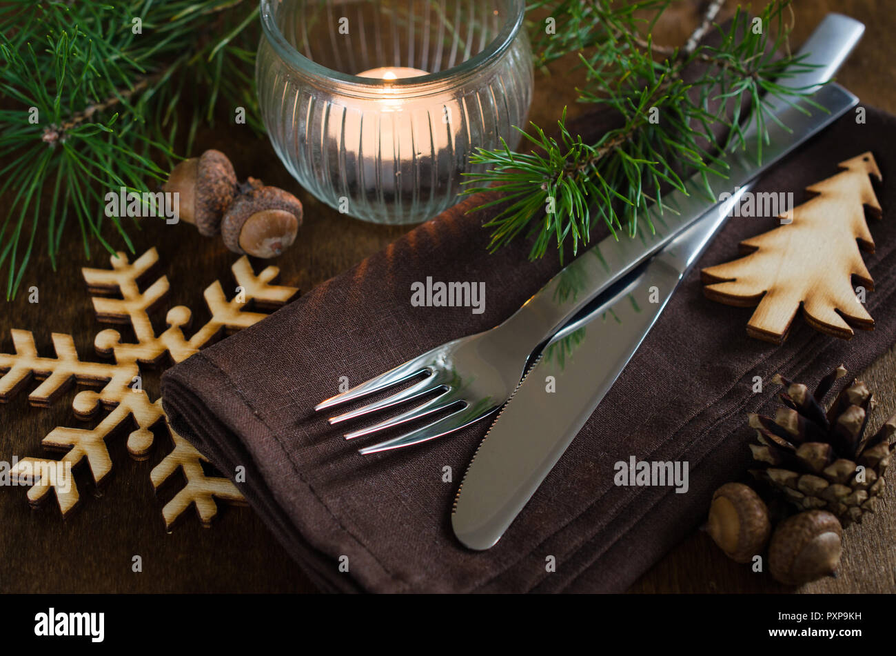 Vintage Or Rustic Christmas Table Setting With Candle And Wooden Decorations Cutlery On Linen Napkin On Rustic Wooden Background Country Style Sel Stock Photo Alamy